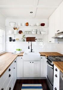 U-shaped-white-kitchen-butcher-block-countertops-butler's-sinkd-Remodelista